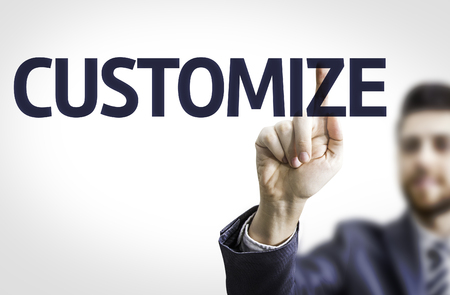 Business man pointing the text Customize Stock Photo