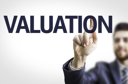 valuation: Business man pointing the text Valuation Stock Photo