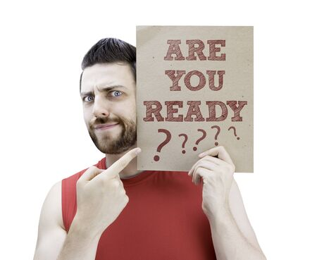man holding card: Man holding card with text Are You Ready on white background Stock Photo