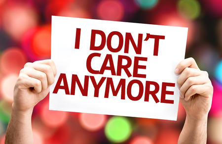 don't care: Hands holding cardboard with text on I Dont Care Anymore bokeh background
