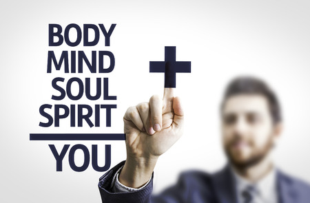 spiritual growth: Business man pointing the text BodyMindSoulSpirit = You Stock Photo