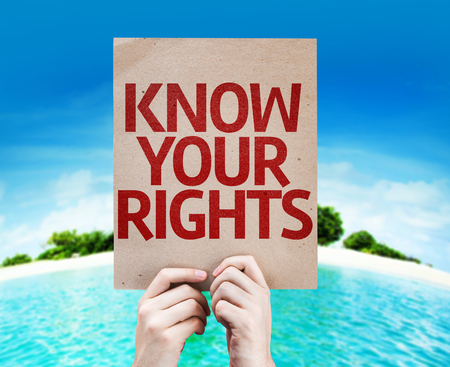Hands holding cardboard with Know Your Rights on island background