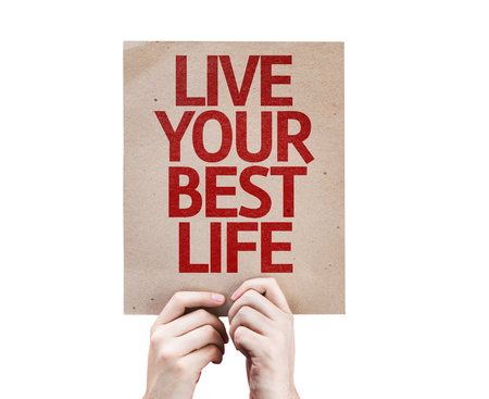 living wisdom: Hands holding cardboard with How To Live Your Best Life on white background