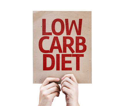 low carb diet: Hands holding cardboard with Low Carb Diet on white background