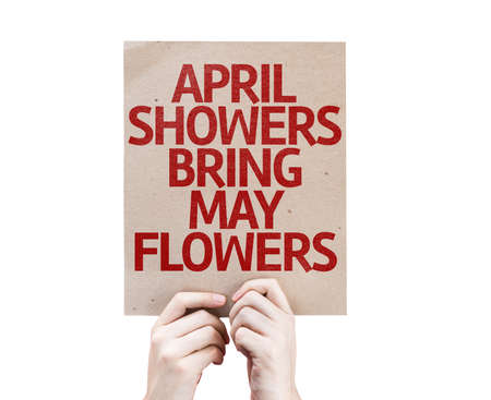 showers: Hands holding cardboard with April Showers Bring May Flowers on white background