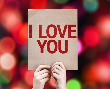 express positivity: Hands holding tablet pc with I Love You on bokeh background