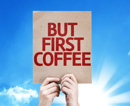 but: Hands holding cardboard with text But First Coffee on sky background