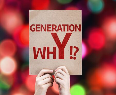 gen: Hands holding cardboard with Generation whY on bokeh background Stock Photo