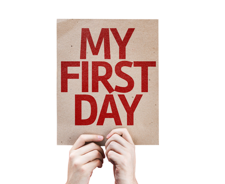 first  day: Hands holding cardboard with My First Day on white background Stock Photo