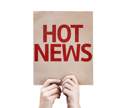 hot news: Hands holding cardboard with Hot News on white background Stock Photo