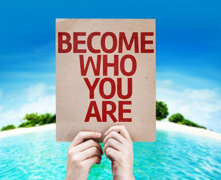 Hands holding cardboard with Become Who You Are on island background