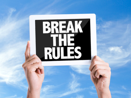disobey: Hands holding tablet pc with Break The Rules on sky background Stock Photo