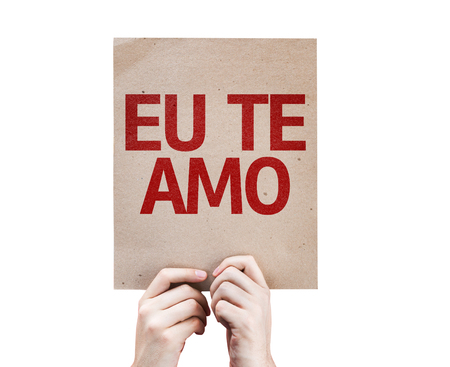 portugese: Cardboard with Holidays, I love you in Portuguese on white background Stock Photo