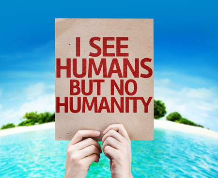 unkind: Hands holding cardboard with I See Humans But No Humanity on island background
