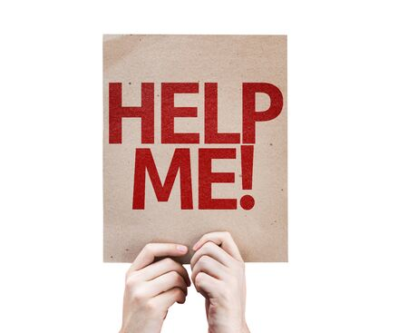 help me: Hands holding cardboard with Help Me on white background Stock Photo