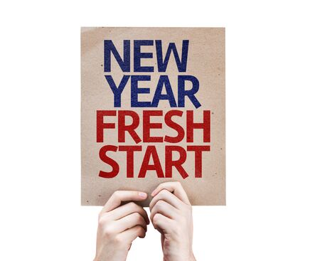 fresh start: Hands holding cardboard with New Year Fresh Start on white background