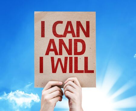 acknowledging: Hands holding cardboard with I Can and I Will on sunny background Stock Photo
