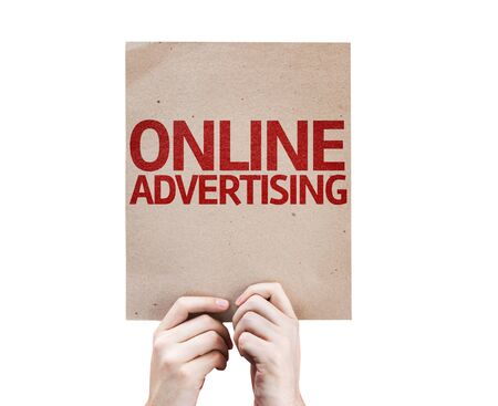 adverts: Hands holding cardboard with Online Advertising on white background