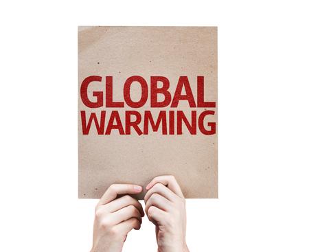 polution: Hands holding cardboard with Global Warming on white background