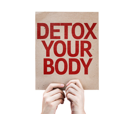 cleanse: Hands holding cardboard with Detox Your Body on white background Stock Photo