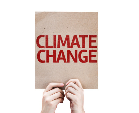 green house effect: Hands holding cardboard with Climate Change on white background