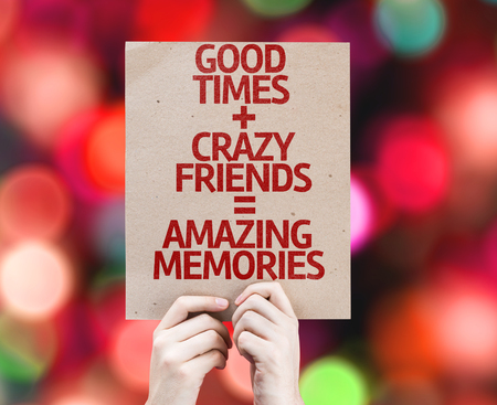 good times: Cardboard with Good Times, Crazy Friends and Amazing Memories on bokeh background