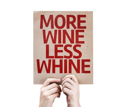 whine: Hands holding cardboard with More Wine Less Whine on white background