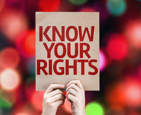 Hands holding cardboard with Know Your Rights on bokeh background Archivio Fotografico