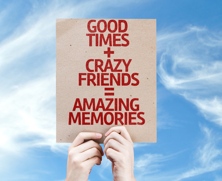 Cardboard with Good Times, Crazy Friends and Amazing Memories on sky background