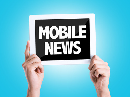 news background: Hands holding tablet pc with Mobile News on blue background Stock Photo