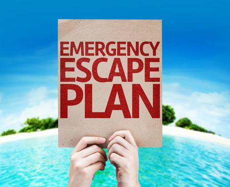 evacuate: Hands holding cardboard with Emergency Escape Plan on island background Stock Photo