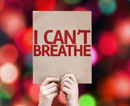 suffocating: Hands holding cardboard with I cant Breathe on bokeh background Stock Photo