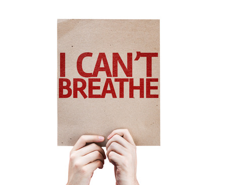suffocating: Hands holding cardboard with I cant Breathe on white background Stock Photo