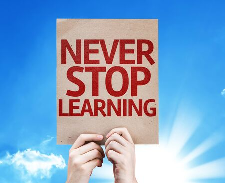 equipping: Cardboard with Never Stop Learning text on sunny background