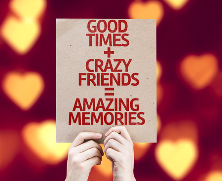 good times: Cardboard with Good Times, Crazy Friends and Amazing Memories on bokeh heart background