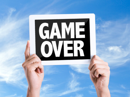 the game is over: Tablet pc with Game Over text on sky background