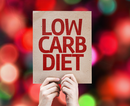 low carb diet: Cardboard Low Carb Diet text on bokeh background Stock Photo