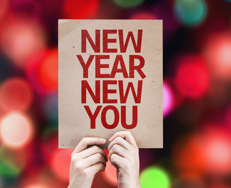 Cardboard with New Year New You on bokeh background