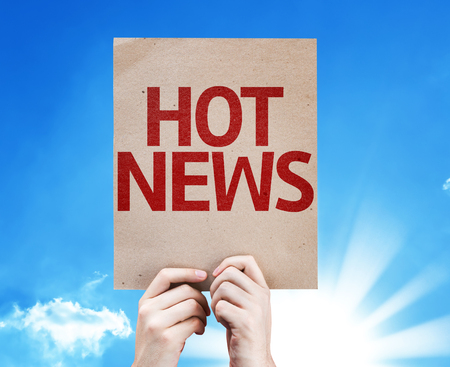 hot news: Cardboard with Hot News text on sunny background