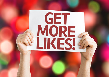 likes: Get More Likes card with colorful background with defocused lights Stock Photo