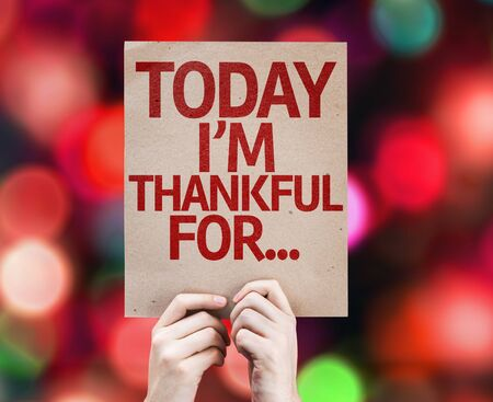 thankfulness: Hands holding Today Im Thankful For... card on bokeh background Stock Photo