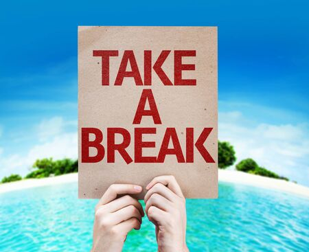 take a break: Hands holding Take a Break card with island background