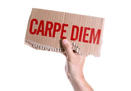 carpe diem: Hand holding Carpe Diem card isolated on white background