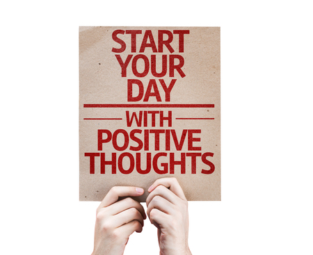 positiveness: Hands holding Start your Day with Positive Thoughts card isolated on white background