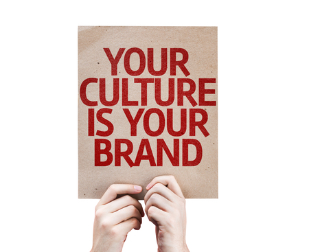 identidad cultural: Hands holding Your Culture is Your Brand card isolated on white background