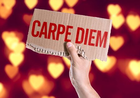 carpe diem: Hand holding Carpe Diem card on heart bokeh background