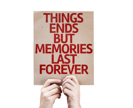 the ends: Hands holding Things Ends but Memories Last Forever card isolated on white