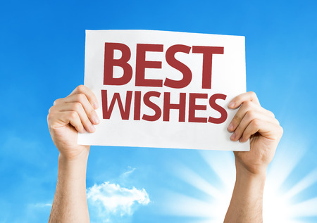 best wishes: Hands holding Best Wishes card with sky background Stock Photo