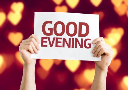 good evening: Hands holding Good Evening on heart bokeh background Stock Photo