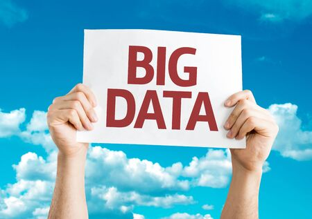 querying: Hands holding Big Data card on sky background Stock Photo